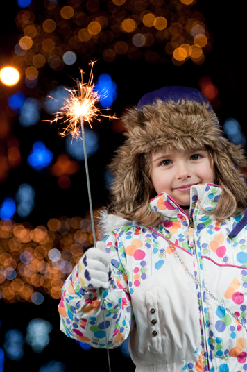 Magic Christmas light  - little girl with firework