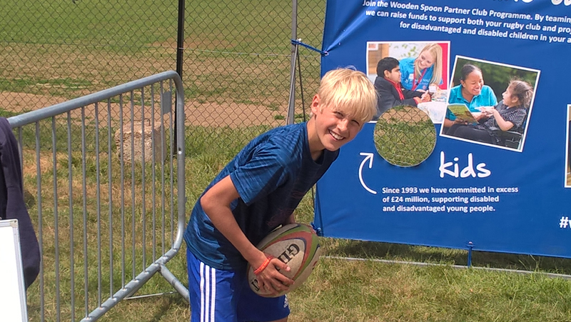 Finn Studer Schrader enjoying rugby at the summer fair