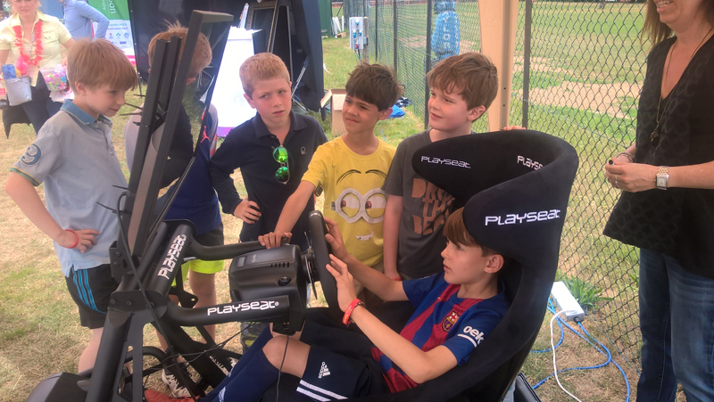 Some of the boys enjoying the arcade racing game kindly donated by Bandai Namco